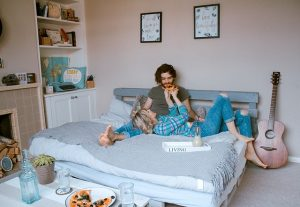 People in bedroom with 3 small succulent plants